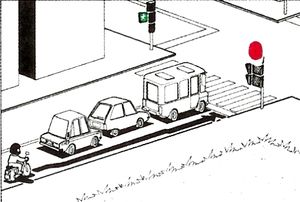 El?rehajthat-e az útkeresztez?désig a motorkerékpáros a piros jelzés alatt az ábrán látható módon?